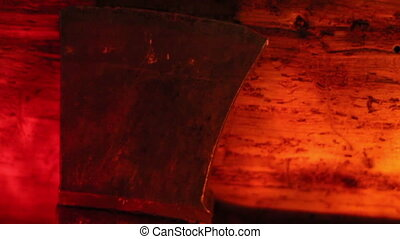 Side view of an axe under a red-lighted room - Side view of...