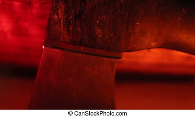 The axe under a red-lighted room - The sharp axe under a...