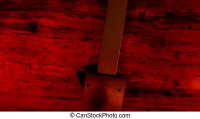 Upside view of a caliper under a red-lighted room