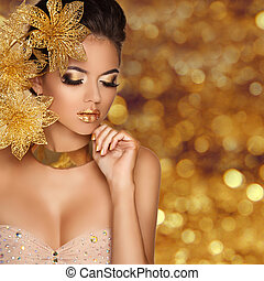 Fashion Beauty Girl portrait with flowers Isolated on golden...