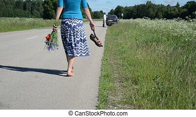barefoot woman road