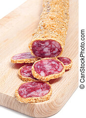 fuet, a spanish sausage, coated with onion - a fuet, a...