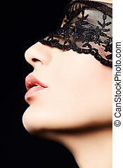 lace mask - Close-up portrait of a charming woman in black...