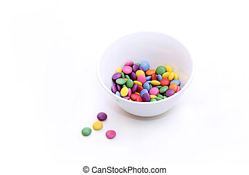 Colorful bright candy in bowl on white