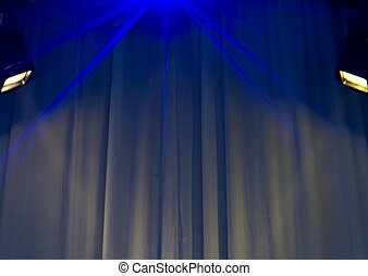 Spotlights shining on a white curtain background