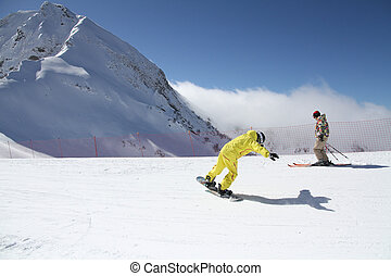 Snowboarder on the slope - Snowboarder on the slope of ski...