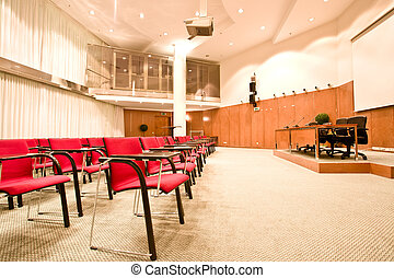 red chairs rows in conference hall