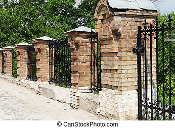 Brick and metal fence in Kiev Pechersk Lavra Monastery in...