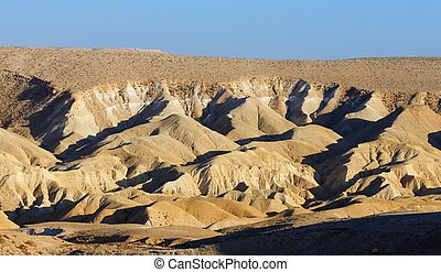 Textured yellow dunes in the desert at sunset in Negev...