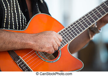 Strumming - Hand of Spanish Guitarist strumming acoustic...