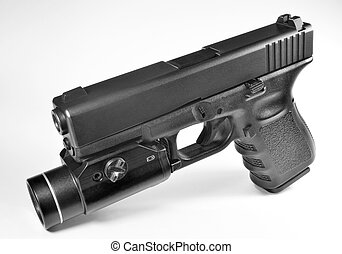 Pistol with flashlight - Glock pistol with attached...