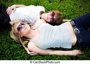 Two girls in sunglasses lays - Two girls in sunglasses lay...