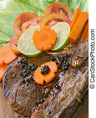 T Bone Pepper Steak with vegetable on Wooden board