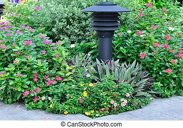 Electric pole in flowers garden