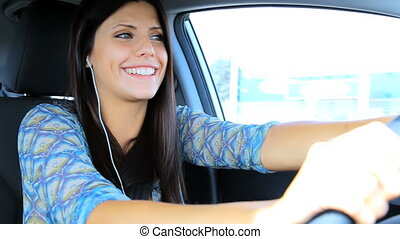 Woman driving talking with friend - Happy woman having fun...
