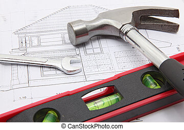construction tools with house blueprint - hammer and water...