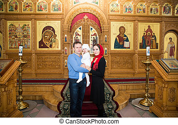Christening. Family celebrating  baptism in Orthodox Church of baby girl