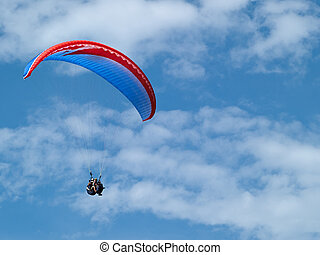 Paragliding against clear blue sky - Paragliding in tandem...