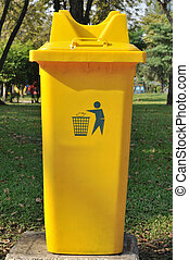 Yellow public bin in garden - Yellow public bin in garden