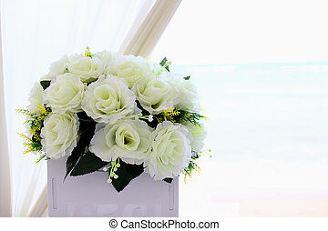 Artificial rose bouquet with sea background