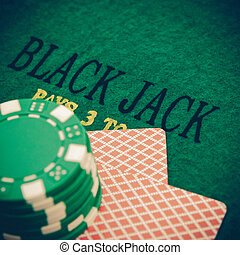 vintage black jack table with red casino chips