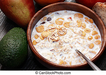 Bowl With Muesli - Wooden bowl with muesli and milk near...