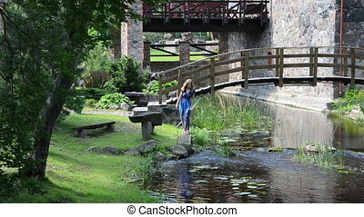park view of summer murmur creek next to a big old house a...