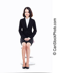 Young Asian business woman sitting on the chair - Young...