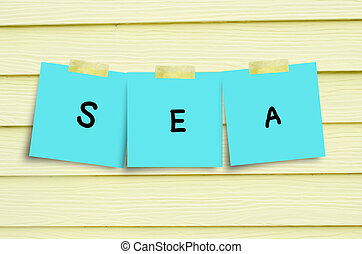 Paper note on wall with sea message