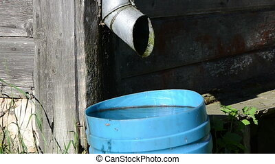 water bucket - tin water run drain pipe and water drops fall...