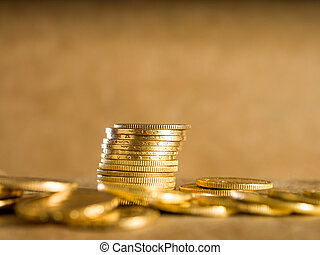 Lots of gold coins - Gold coins over brown background
