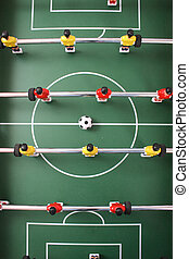 table soccer with players and a ball