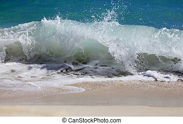 Atlantic Ocean - Big wave crashes on to the shore. Atlantic...