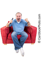 Man screaming at the television - Middle-aged bearded man...