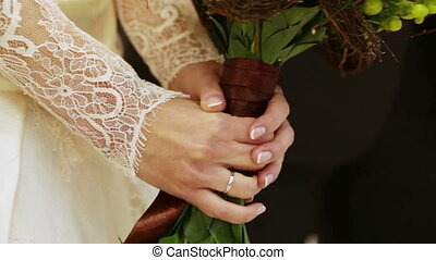 Original wedding bouquet Hands of bride holding a wedding...