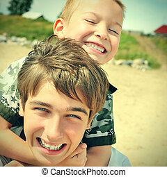 Happy Brothers Portrait - Toned photo of Happy Teenager and...