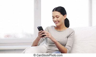 woman with cell phone sending text message - internet,...