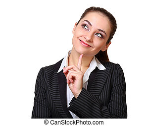 Smiling business woman thinking with finger under face and...