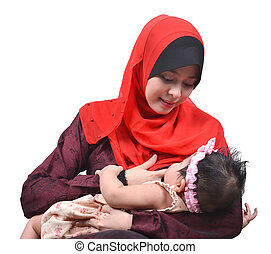 Young Asian muslim mother breastfeeding her cute baby girl...