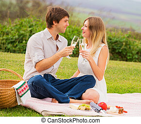 Attractive couple on romantic afternoon picnic - Attractive...
