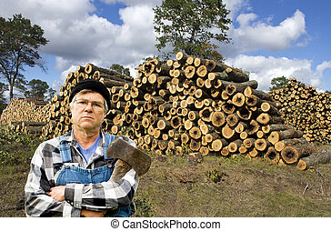 lumberjack and logs - male lumberjack standing in front of a...