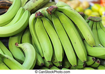 Green bananas - Big bunch of green bananas at grocery store