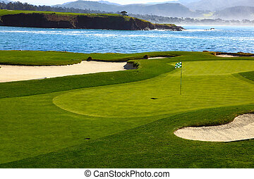 Golf course green - This is a Golf course green with ocean...
