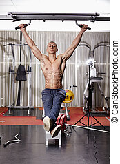 Athletic man doing hanging legs raise - Athletic man working...