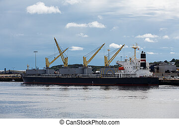 Yellow Winches on Dockside Freighter - A large freighter at...