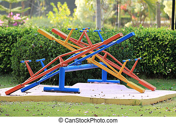 Colorful seesaw on a playground in a sunny day
