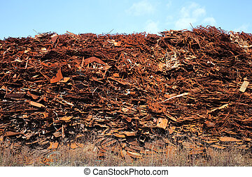 Pile of scrap metal against blue sky