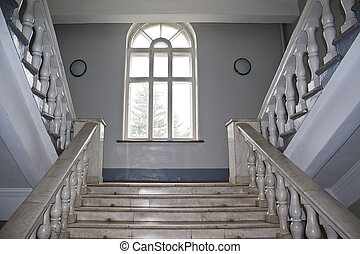 Marble staircase and window in an old building