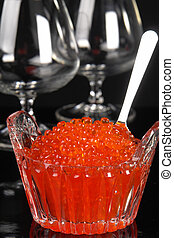 Red caviar on a black background...