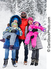 Happy Family with children in ski suit in snowy winter...